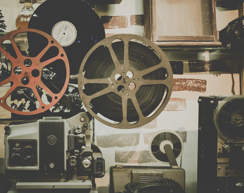 Old movie projector with a film reel on