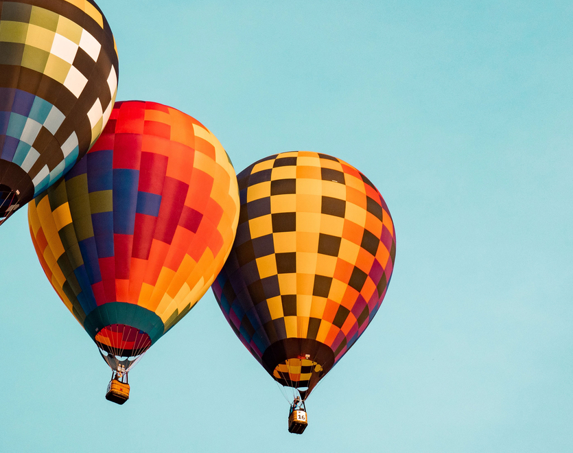 Three hot air balloons on the sky.